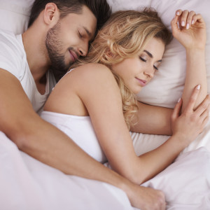 Sleeping couple in the comfortable bed