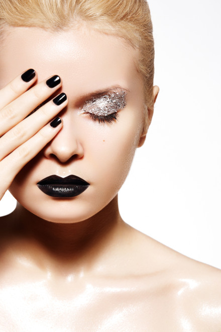 Fashion silver make-up. Shiny wet skin, black lips and nails