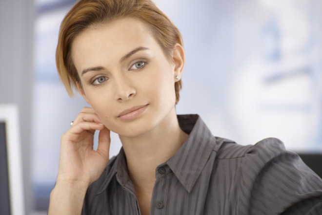 Beautiful daydreaming businesswoman