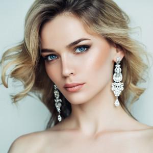 Beautiful girl with shiny earrings