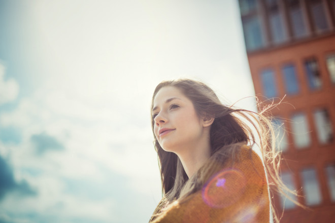Girl enjoying sunlight with dreamy look