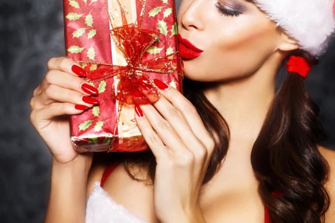Sexy santa woman kissing gift