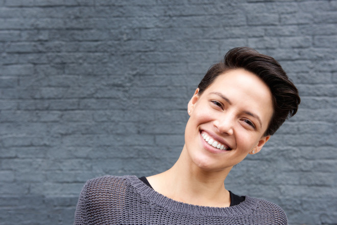Close up smiling young woman with short hair