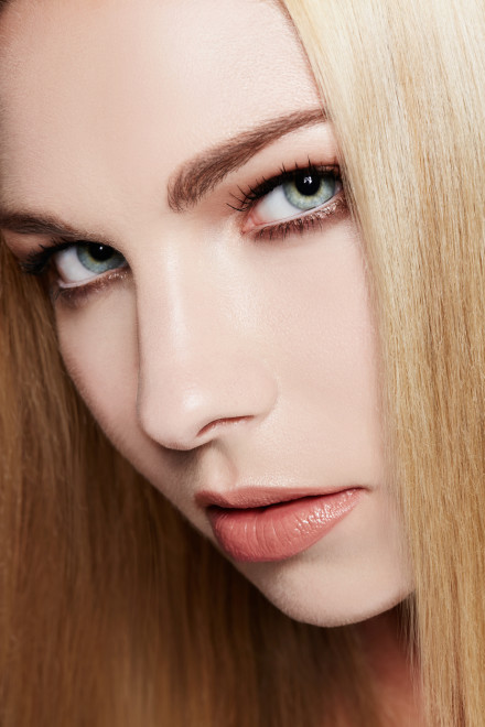 Beautiful girl with blonde hair and blue eyes.Close up