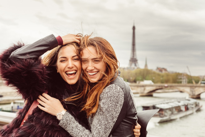 Happy girls in Paris against the Eiffel tower
