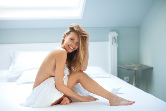 Sensual woman having fun in the bedroom