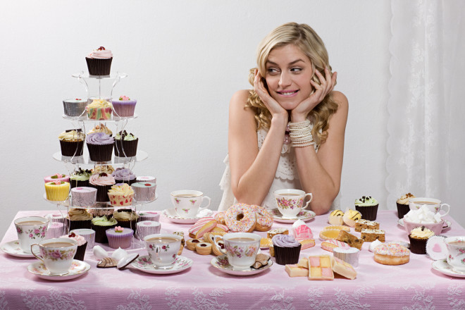 Woman with table of tea and cakes