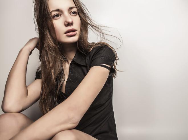 Portrait of a young beauty. Close-up studio photo.
