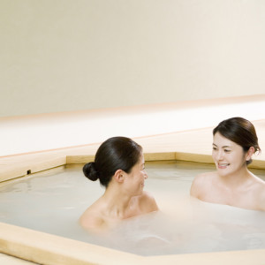 Two women taking bath together