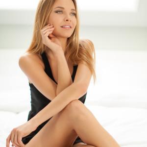 Sensual woman posing in the bedroom