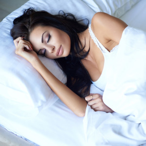 Beautiful young woman sleeping peacefully in bed