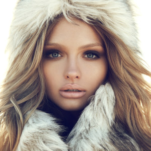 Beauty Fashion Model Girl in a Fur Hat. Winter Woman