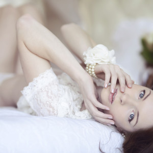 Beautiful sexy lady in elegant white panties and bra