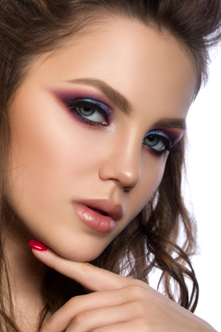 Close up portrait of young beautiful woman with fashion makeup