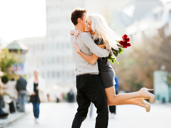 Cheerful embraced couple.