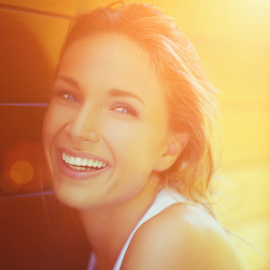 Beauty portrait of a young blonde woman with beautiful smile