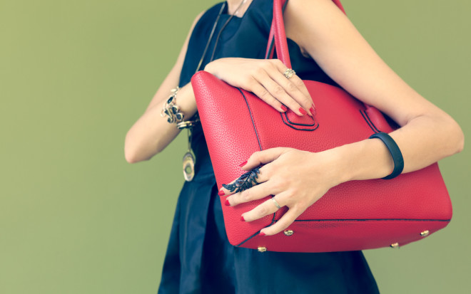Fashionable beautiful big red handbag on a shoulder