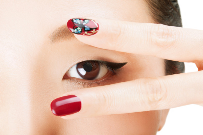 Asian beautiful eyes with V sighn and Nail art