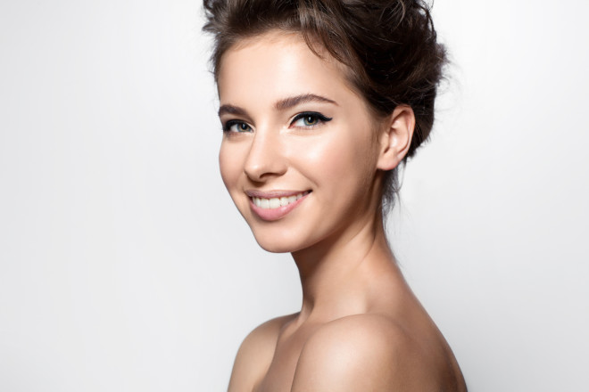 Happy woman with clean skin, natural make-up