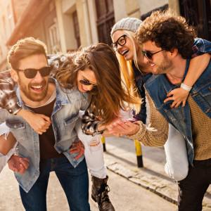 Photo of friends having fun in city