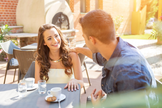 Young couple talking on the terrace of  restaurant