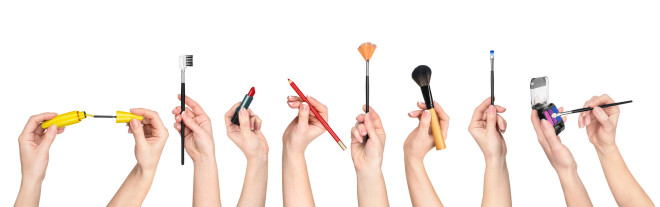 collection of hands holding tools for makeup