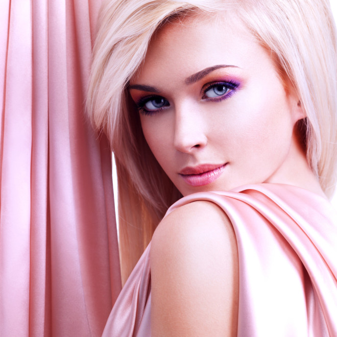 Beautiful tender woman with pink silk.