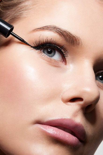 Close-up of beautiful model's face with black eyeliner