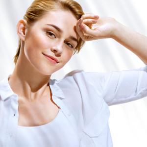 Beautiful sensual blonde girl in white blouse