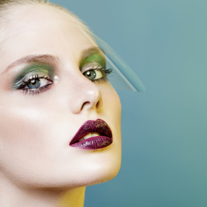 beautiful girl with vinous lips and green eyeshadows