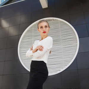 Model looking away against of building wall