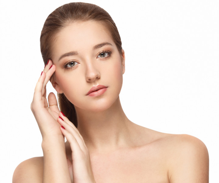 Woman studio portrait beautiful close-up with healthy skin happy