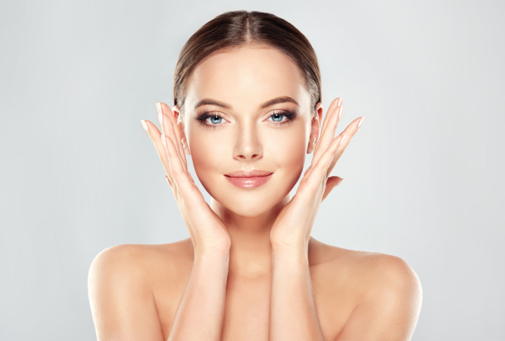 Woman with Clean Fresh Skin touch own face