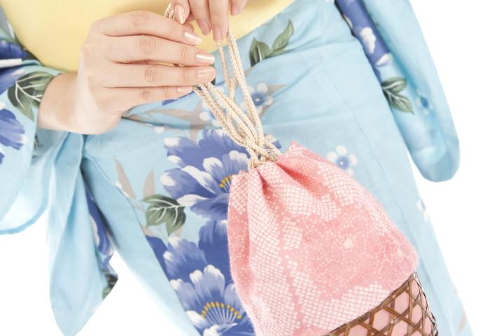Yukata woman with a bag in hand