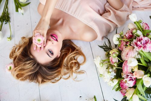 young blonde woman in flowers