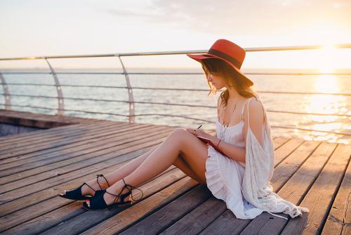 young stylish beautiful woman writing diary book