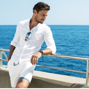 handsome-man-wearing-white-clothes-posing-in-sea-scenery-picture-id537548268