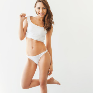 Woman in white undergarments, posing