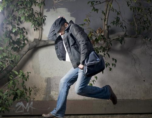 Young man running away