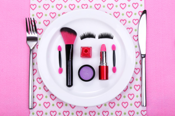 Makeup accessories on plate