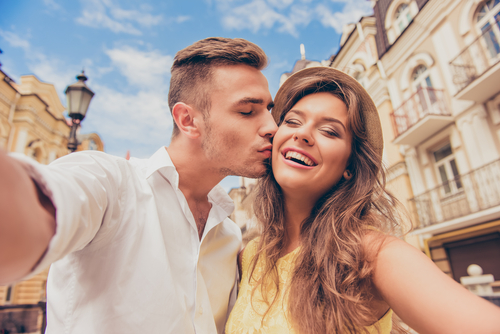couple making selfie photo with kiss