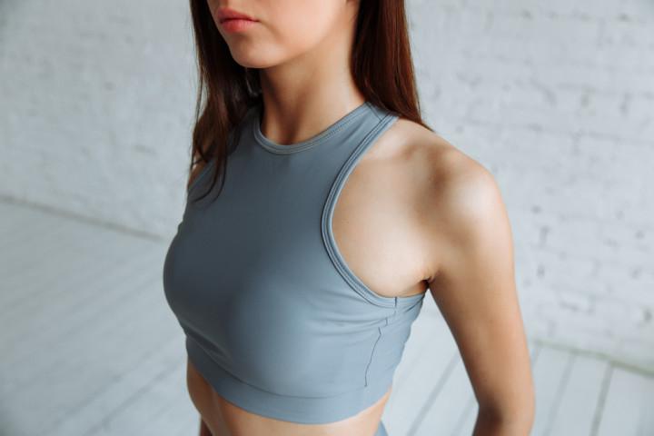 a fit woman wearing a sports bra