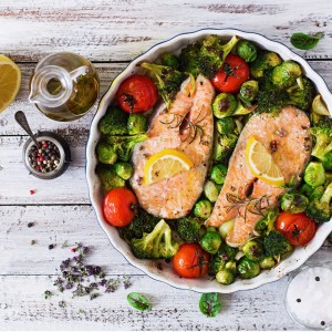 baked-salmon-steak-with-vegetables-diet-menu-top-view-picture-id502701410