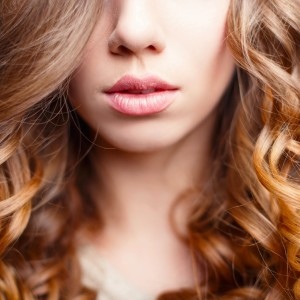 beautiful-pink-lips-closeup-girl-with-curly-hair-picture-id547523910