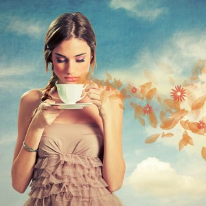 beautiful-young-woman-holding-a-cup-of-tea-picture-id164207682