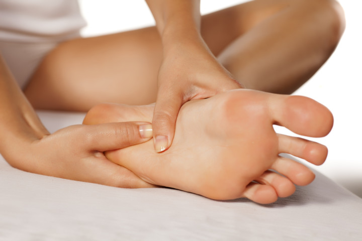 woman massaging her tired feet