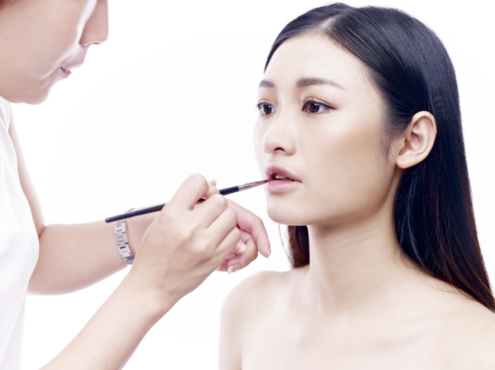 makeup artist working on young model
