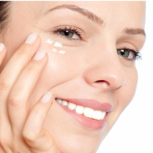 skin-care-woman-putting-face-cream-picture-id465525193