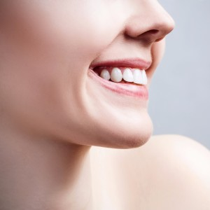 face-of-young-woman-with-healthy-white-teeth-picture-id854979940