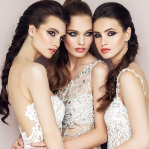 three-beautiful-girls-with-perfect-hairstyle-and-makeup-picture-id681428554